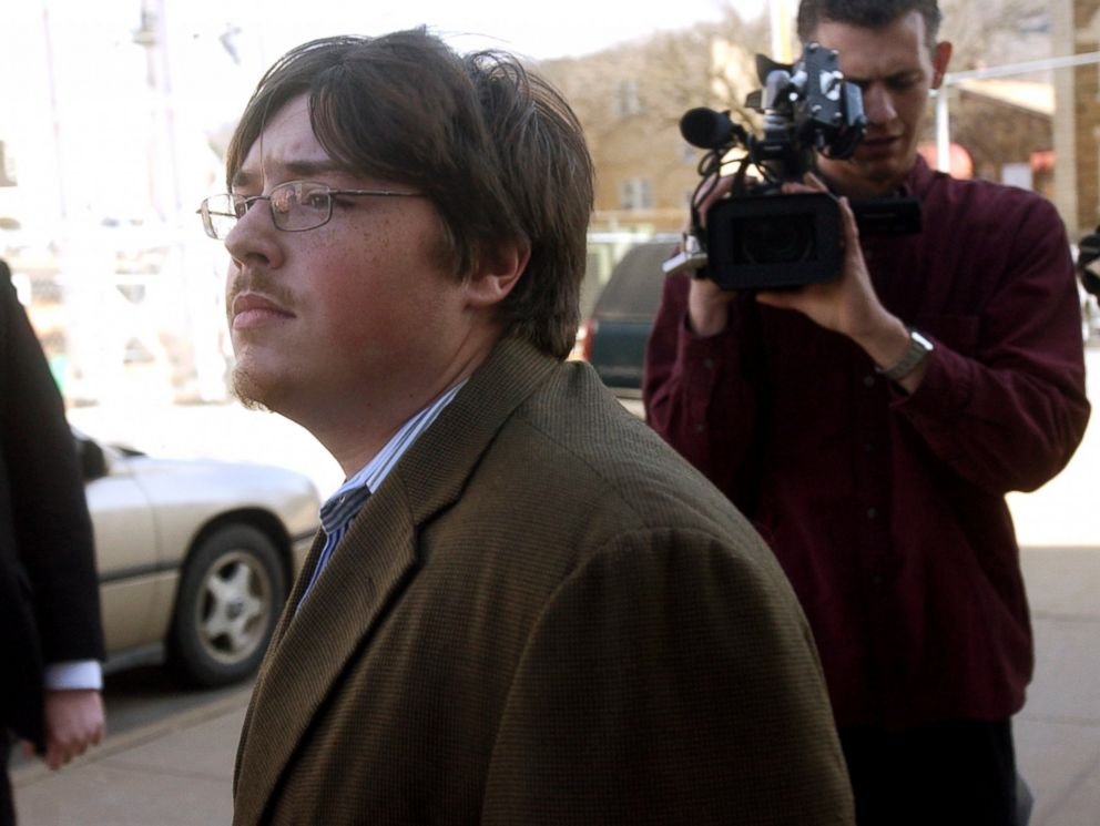 PHOTO: Jonesboro school shooter Mitchell Johnson, center, walks past members of the media during a lunch break from his trial at the Federal Building, Jan. 29, 2008 in Fayetteville, Ark.