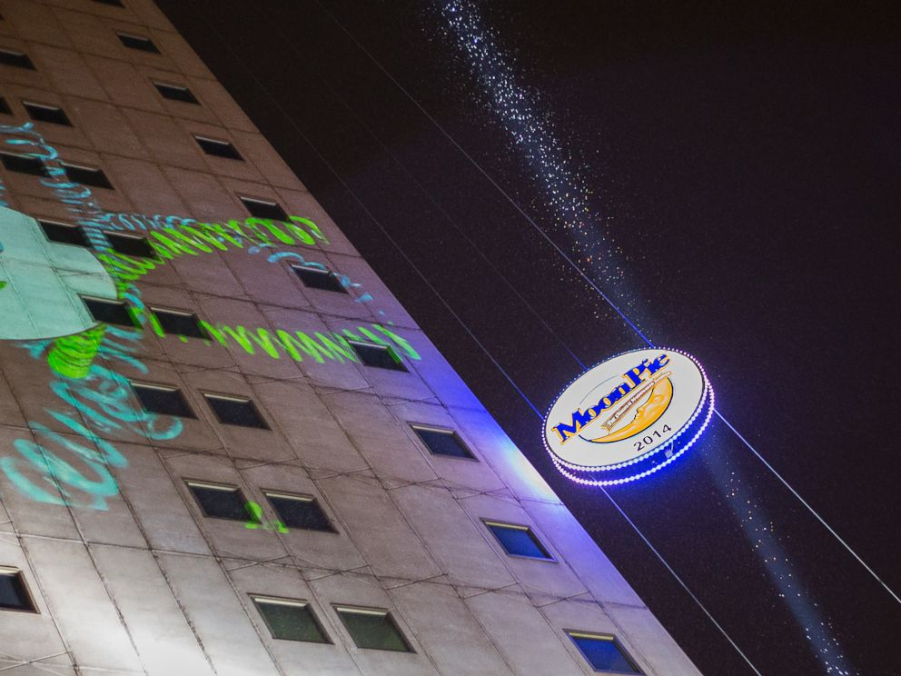 PHOTO: A large, illuminated Moon Pie descends from the RSA BankTrust Building during the Moon Pie Over Mobile New Years Eve Celebration welcoming the arrival of 2014 in downtown Mobile, Ala.