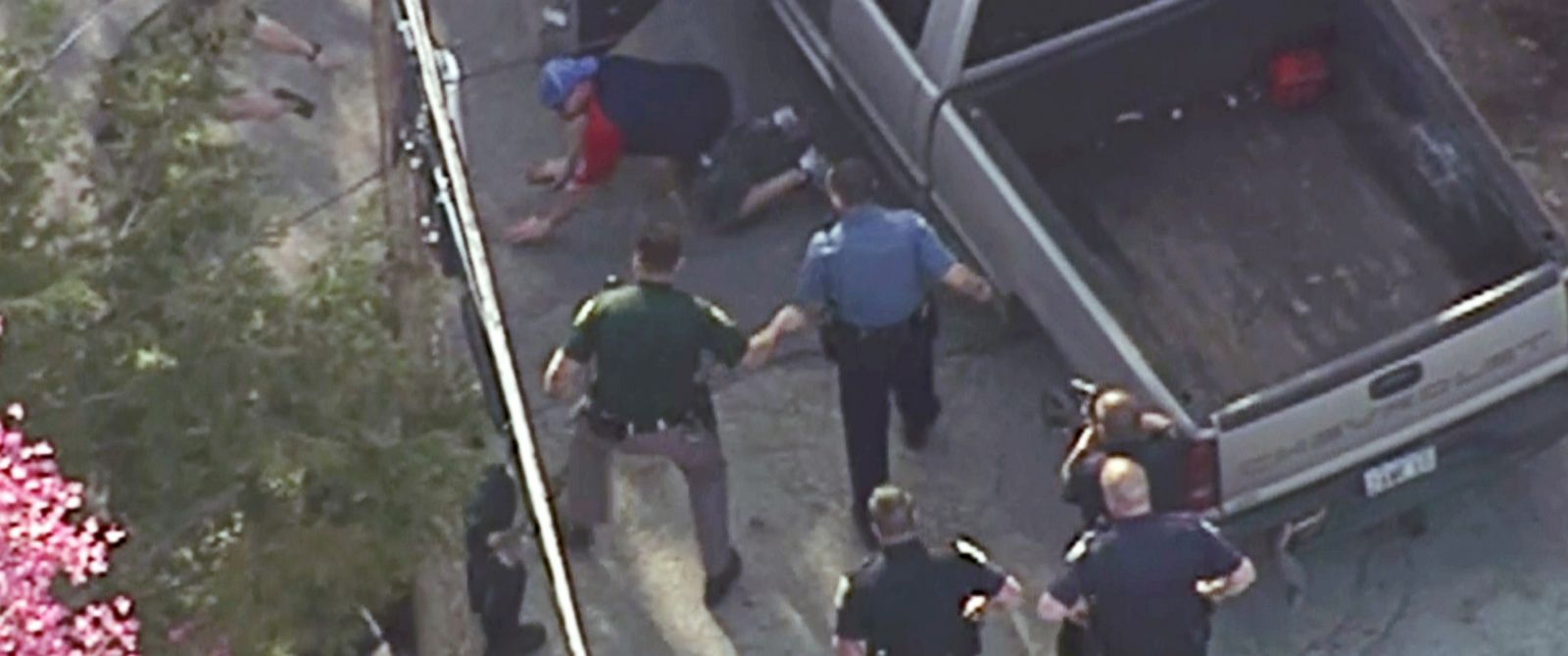 PHOTO: This aerial image made from a helicopter video provided by WHDH shows Richard Simone kneeling and putting his hands on the ground after a high-speed police pursuit in Nashua, N.H., May 11, 2016.