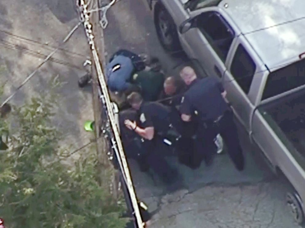 PHOTO: This aerial image made from a helicopter video provided by WHDH shows several officers arresting Richard Simone after a high-speed police pursuit in Nashua, N.H., May 11, 2016.
