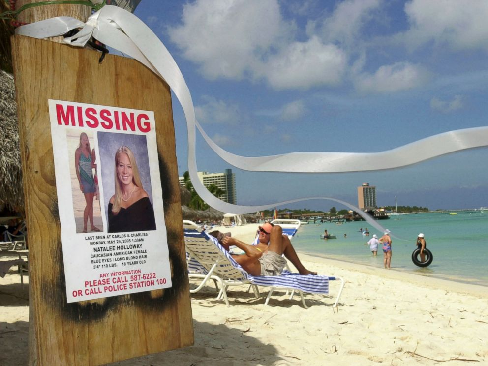 PHOTO: A missing poster for Natalee Holloway, a high school graduate of Mountain Brook, Ala., who disappeared while on a graduation trip to Aruba on May 30, 2005, is seen on Palm Beach, Aruba.