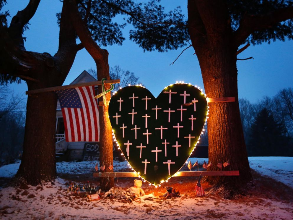 PHOTO: A memorial with crosses for the victims of the Sandy Hook Elementary School shooting massacre stands outside a home in Newtown, Conn., on the one-year anniversary of the shootings, Dec. 14, 2013.