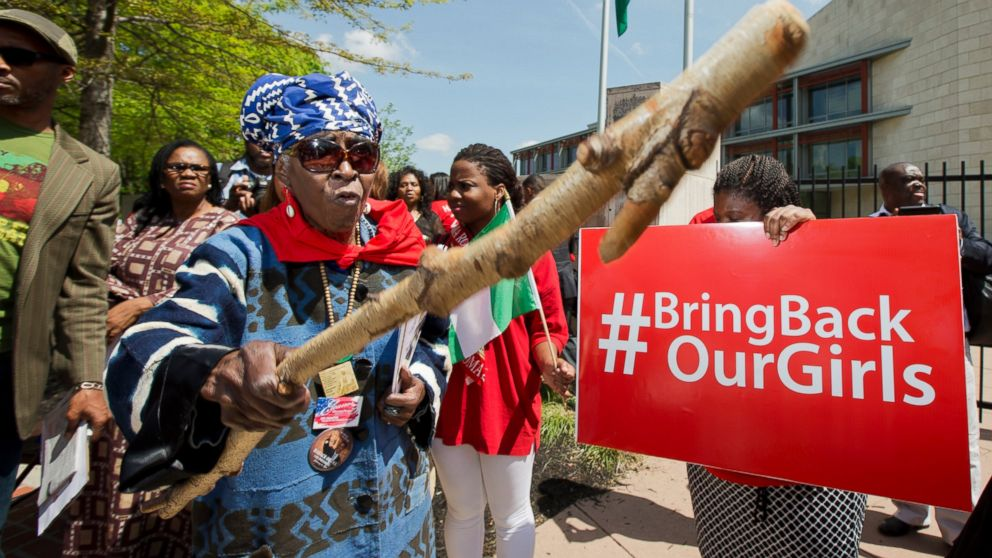 PHOTO: Mia Kuumba, a resident of Washington, D.C., brandishes a wooden stick during a rally