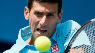 PHOTO: Novak Djokovic of Serbia returns the ball against Gael Monfils of France at the Rogers Cup tennis tournament, Aug. 6, 2014 in Toronto.