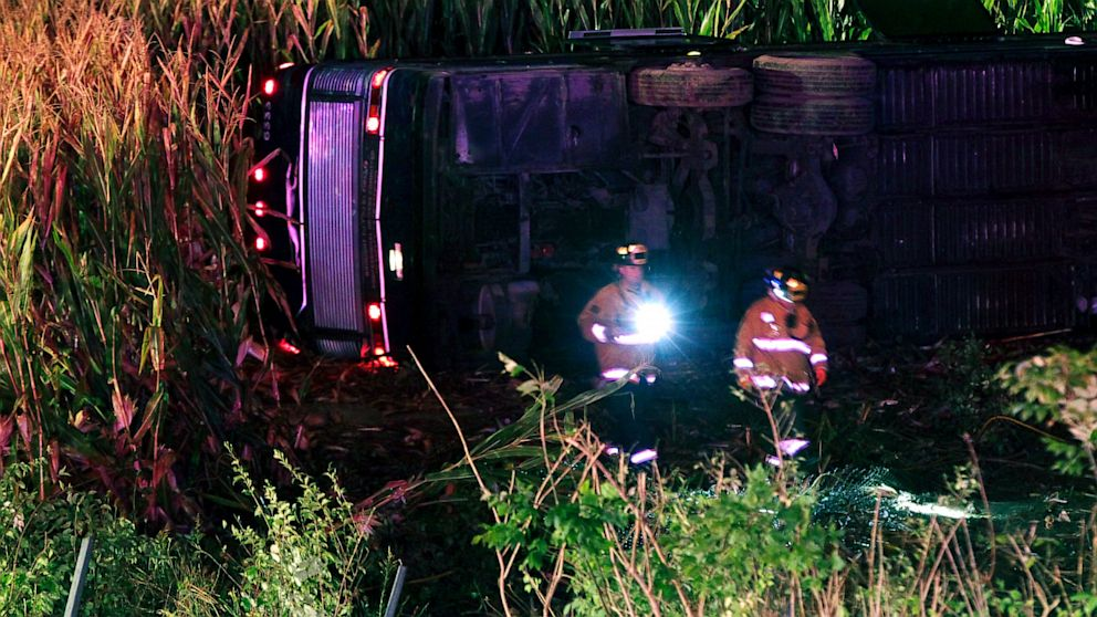 PHOTO: Officials work the scene of an overturned Greyhound bus on interstate I-75 in Liberty Township, Ohio on Saturday, Sept. 14, 2013. Authorities say that at least 34 people have been hurt, with injuries ranging from minor to severe.