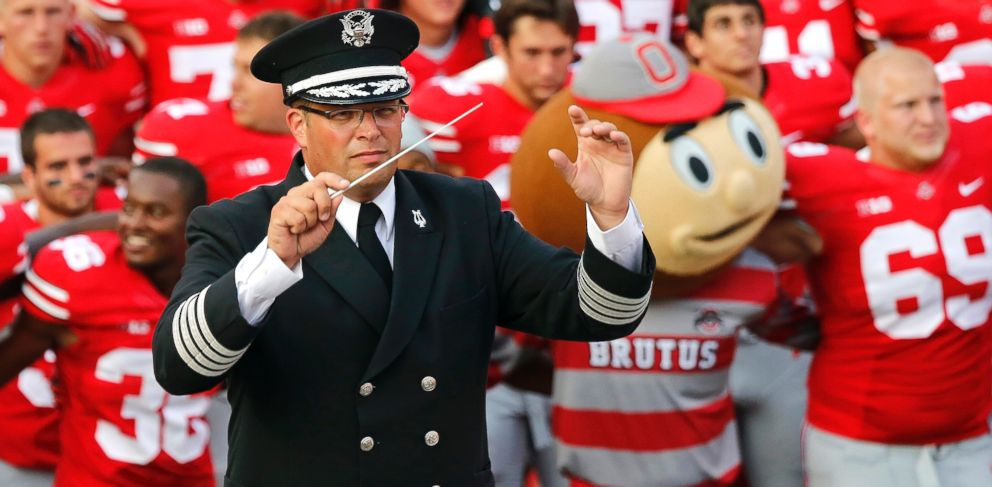 PHOTO: Ohio State University marching band director Jon Waters leads the band in Carmen Ohio following a NCAA football game against San Diego State at Ohio Stadium in Columbus, Ohio, Sept. 7, 2013.