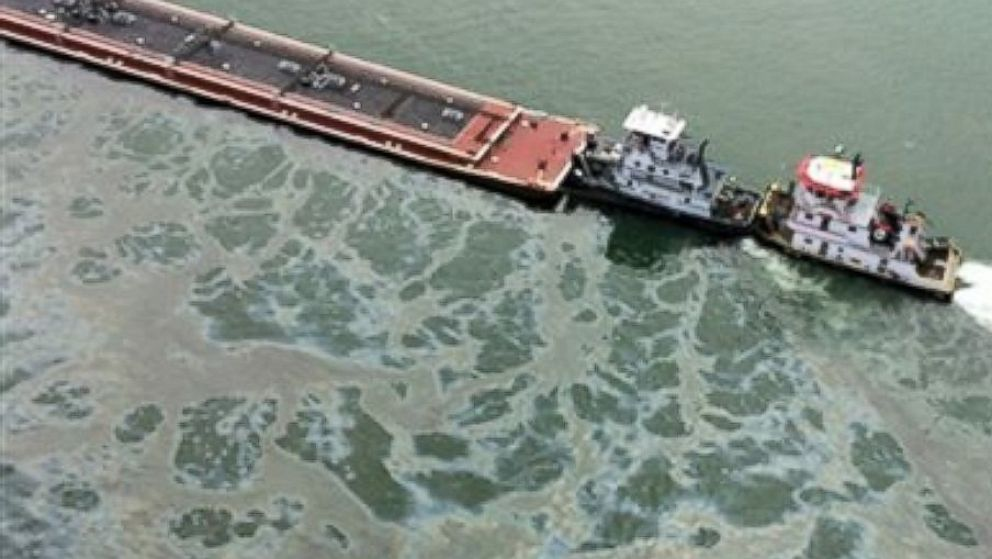PHOTO: A barge loaded with marine fuel oil sits partially submerged in the Houston Ship Channel, March 22, 2014. The bulk carrier Summer Wind, reported a collision between the Summer Wind and the barge, containing 924,000 gallons of fuel oil.