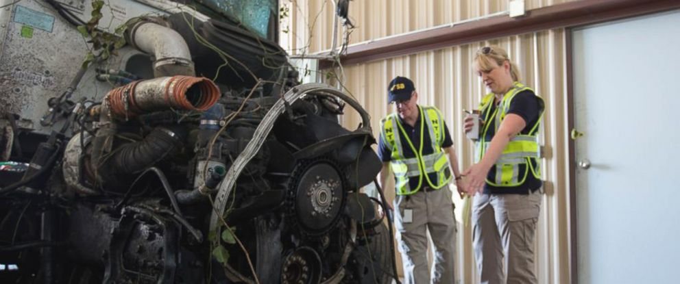 PHOTO: In this photo provided by The National Transportation Safety Board, officials examine part of the wreckage involved in a fatal highway accident in Davis, Okla.