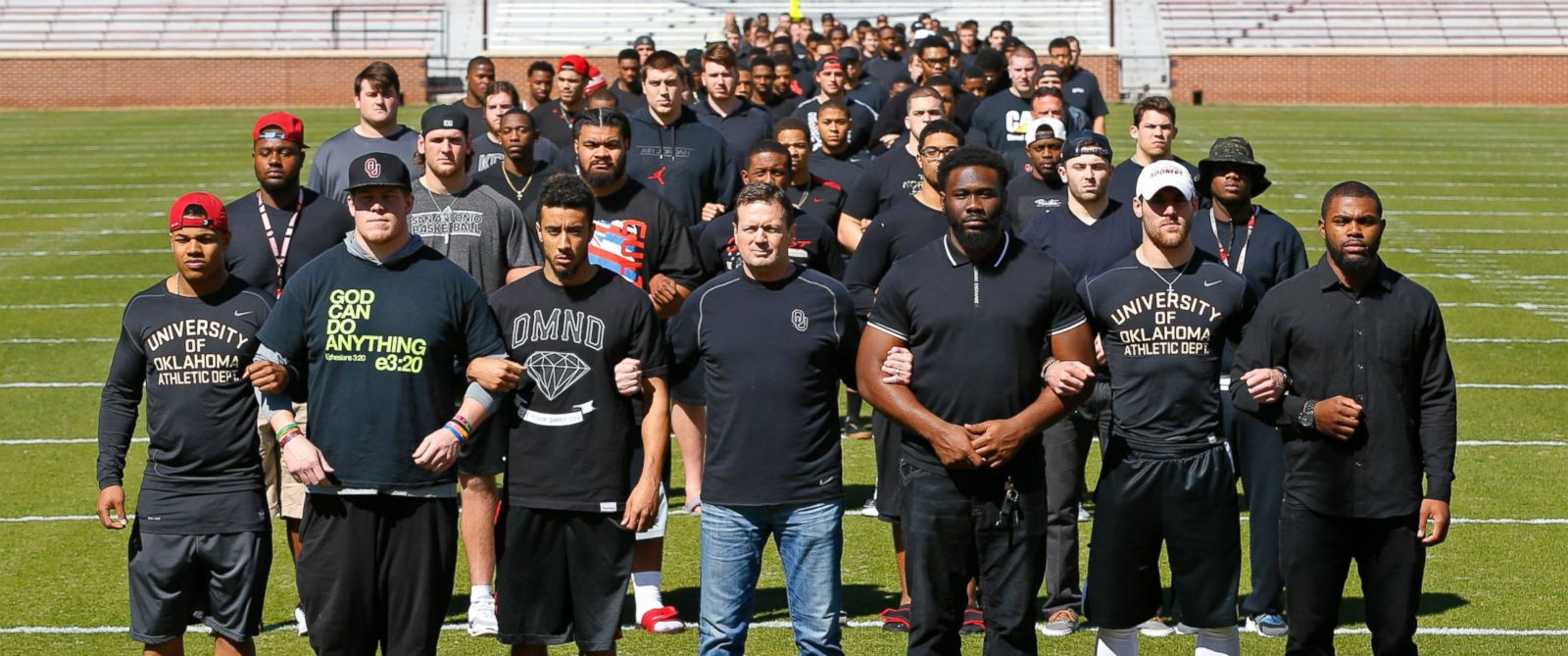 PHOTO: The University of Oklahoma football team stands arm in arm on Owen Field on the campus in Norman, Okla., March 12, 2015, in response to the recent racist video from a now-closed campus fraternity.