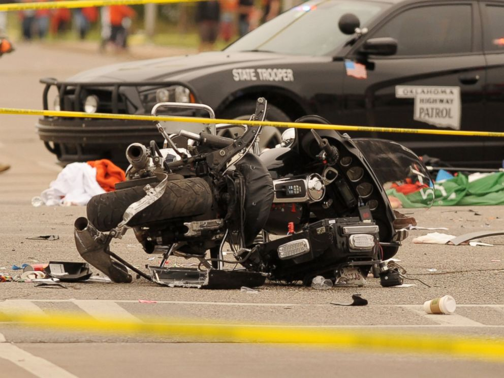 PHOTO: A damaged police motorcycle rests in the intersection after a vehicle crashed into a crowd of spectators during the Oklahoma State University homecoming parade, causing multiple injuries, Oct. 24, 2015 in Stillwater, Oka.