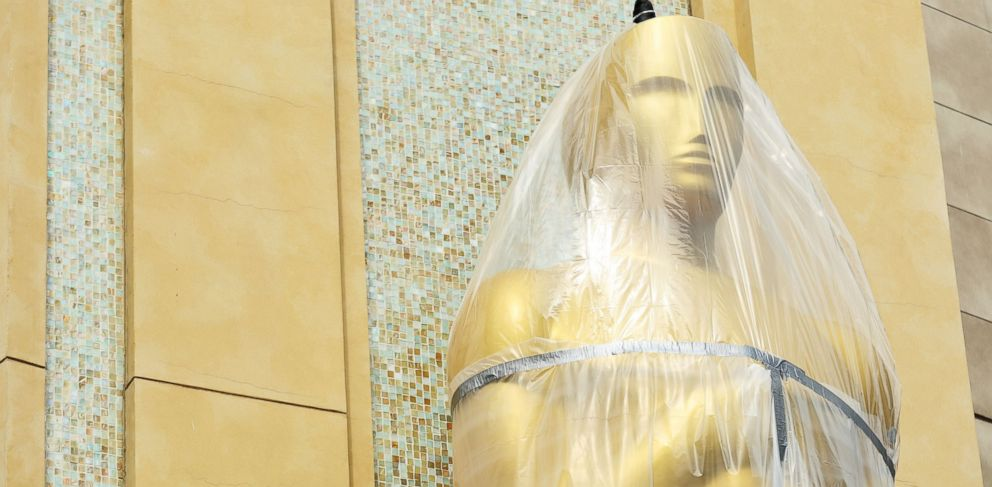 PHOTO: An Oscar statue is covered in plastic as preparations are made for the 86th Academy Awards in Los Angeles, Wednesday, Feb. 26, 2014.