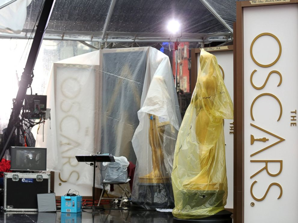 PHOTO: A pair of Oscar statues are seen on the red carpet as preparations are made during rainy weather for the 86th Academy Awards in Los Angeles, Friday, Feb. 28, 2014.