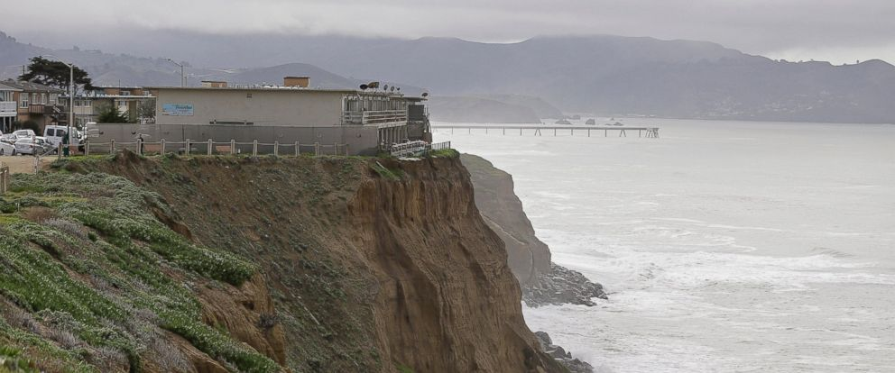PHOTO: An apartment complex stands on the edge of an eroding cliff with the Pacifica Pier in the background, Jan. 25, 2016, in Pacifica, Calif. The city manager of Pacifica has declared a local emergency.
