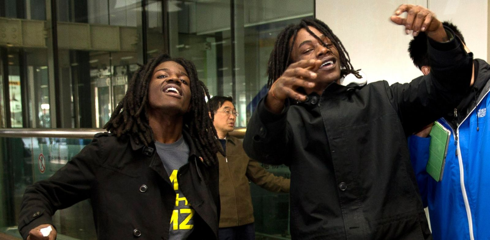 PHOTO: U.S. rappers Pacman, left, and Peso perform a dance at the Beijing Capital Airport in Beijing, after returning from Pyongyang, North Korea Saturday, Nov. 30, 2013.