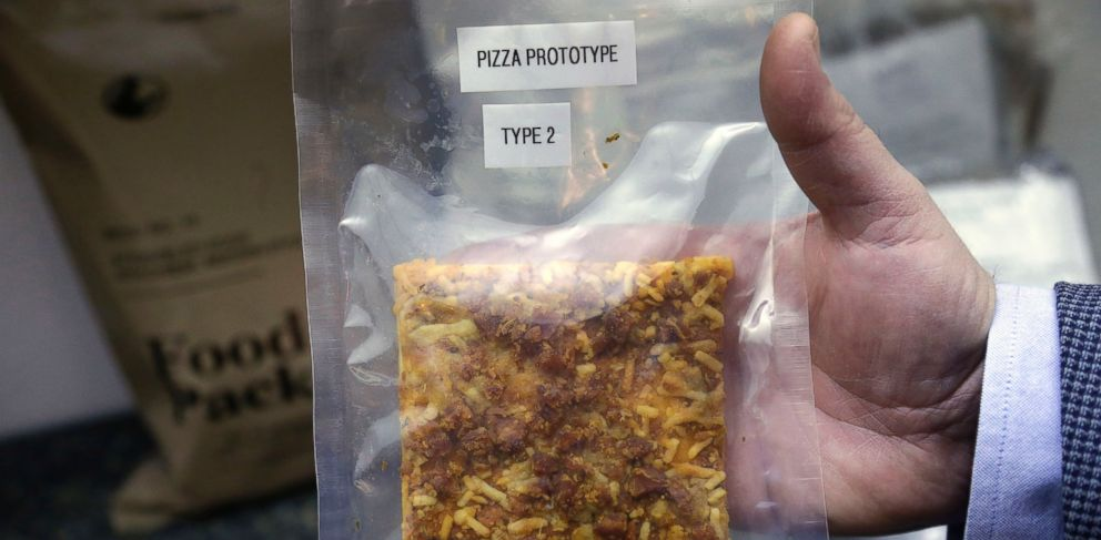 PHOTO: A packet containing a slice of prototype pizza is displayed by public affairs officer David Accetta at the U.S. Army Natick Soldier Research, Development and Engineering Center, in Natick, Mass., Feb. 6, 2014.