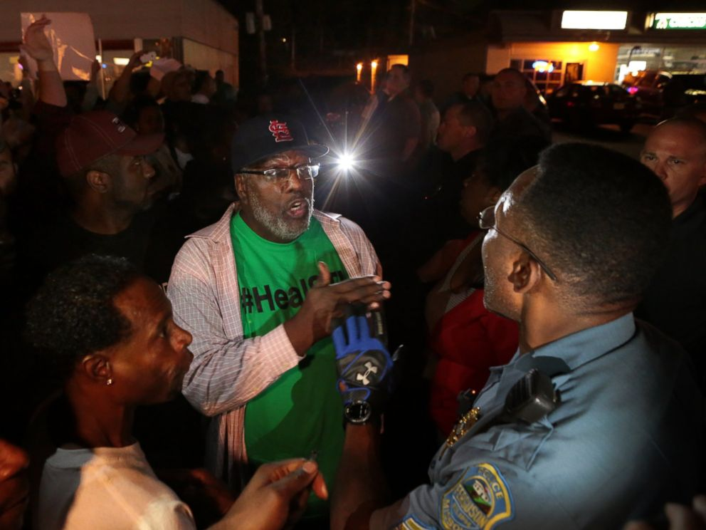 PHOTO: Protesters argue with a Ferguson sergeant who was trying to get them to disperse the area on West Florissant Avenue in Ferguson, Mo., Sept. 23, 2014.