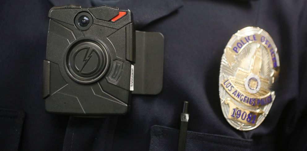 FILE - In this Jan. 15, 2014 file photo, a Los Angeles Police officer wears an on-body camera during a demonstration for media in Los Angeles.