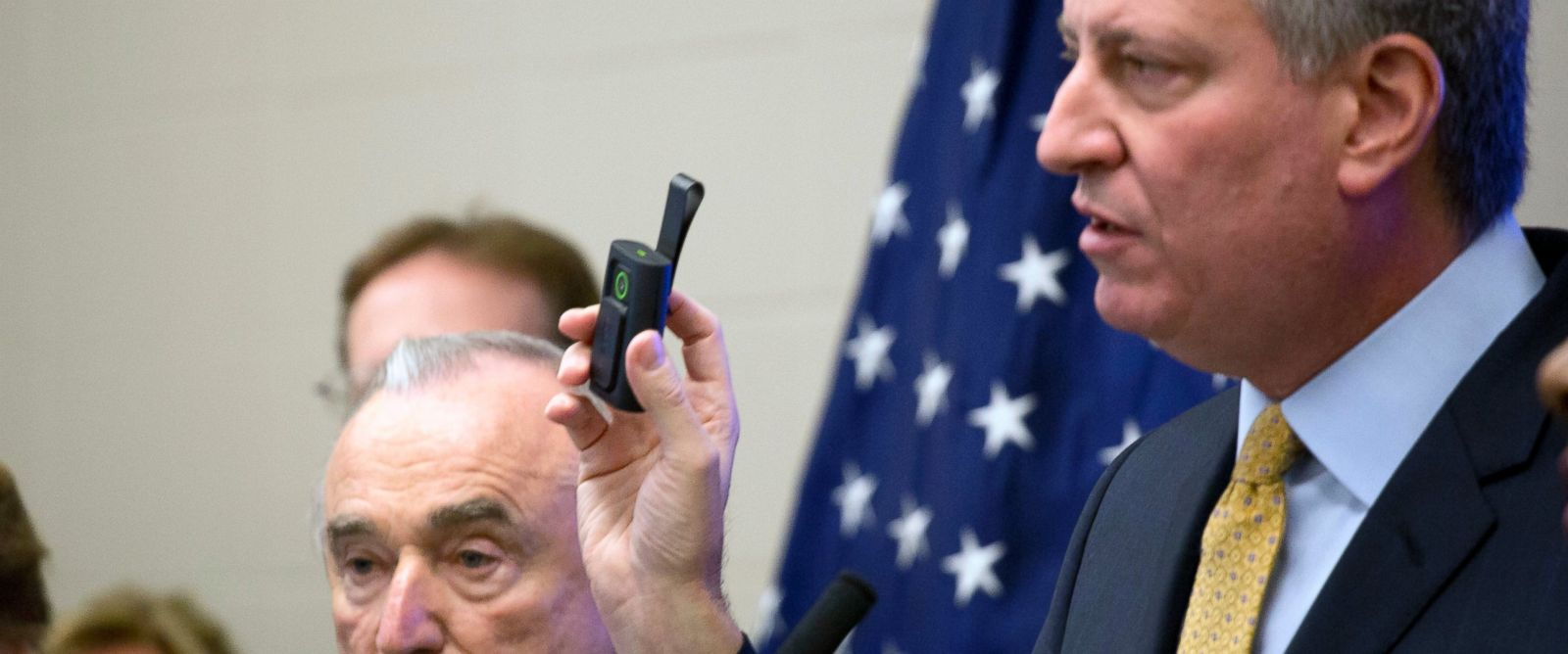 PHOTO: New York Mayor Bill de Blasio holds a body camera during a news conference to discuss a pilot program for the use of body cameras for some police officers, at the Police Academy in Queens, Dec. 3, 2014 in New York.