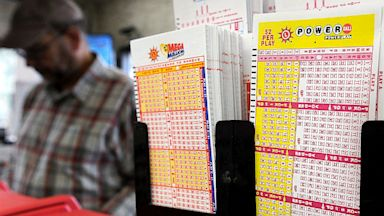 PHOTO: Forms for the Powerball lottery wait to be filled out at a gas station in Bowie, Md., Aug. 6, 2013.