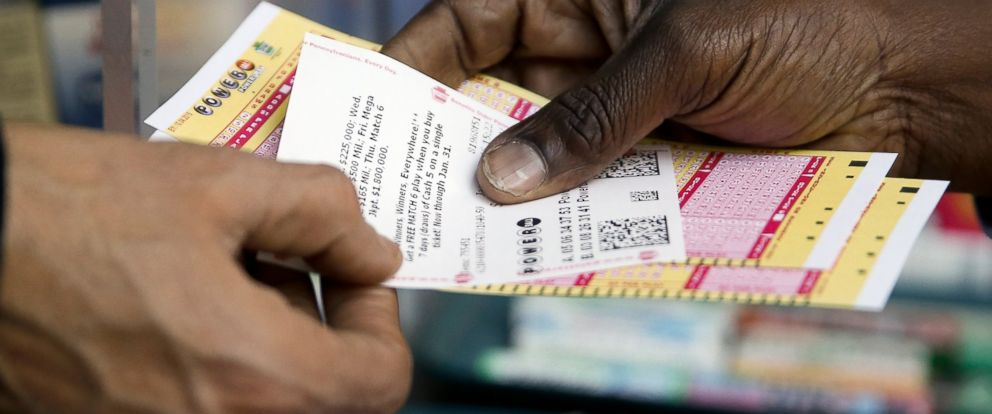 PHOTO: A person purchase Powerball lottery tickets from a newsstand, Jan. 6, 2016, in Philadelphia.