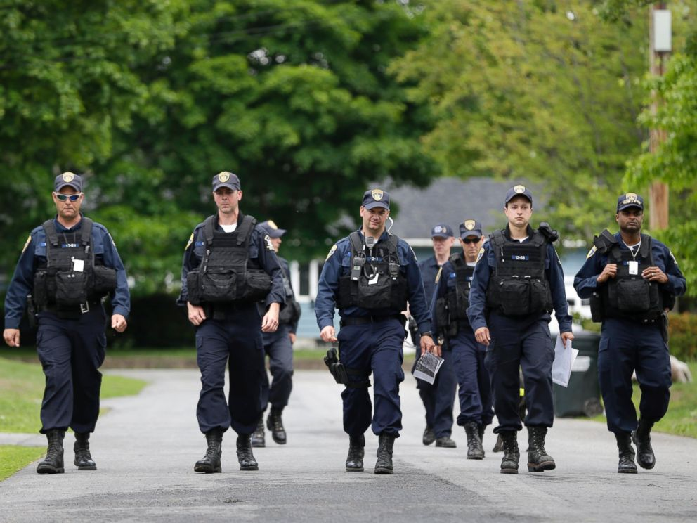 PHOTO: Law enforcement officers walk the streets in Dannemora, N.Y., as they searched houses near the maximum-security prison in northern New York where two killers escaped using power tools, June 10, 2015.