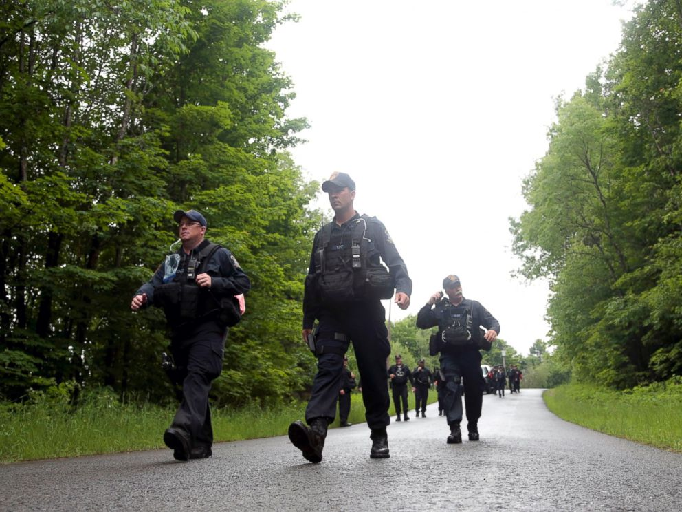 PHOTO: Corrections officers walk along a road after leaving a wooded area while searching for two prison escapees from Clinton Correctional Facility in Dannemora, June 23, 2015, in Owls Head, N.Y.