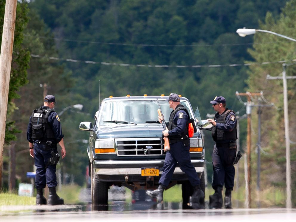 PHOTO: Corrections officers stop a vehicle as the search for two escaped prisoners from Clinton Correctional Facility in Dannemora continues, June 22, 2015, in Owls Head, N.Y.