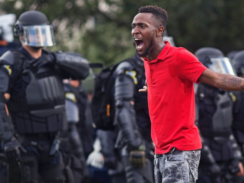 PHOTO: A protester yells at police in front of the Baton Rouge Police Department headquarters after police arrived in riot gear to clear protesters from the street in Baton Rouge, Louisiana, July 9, 2016.