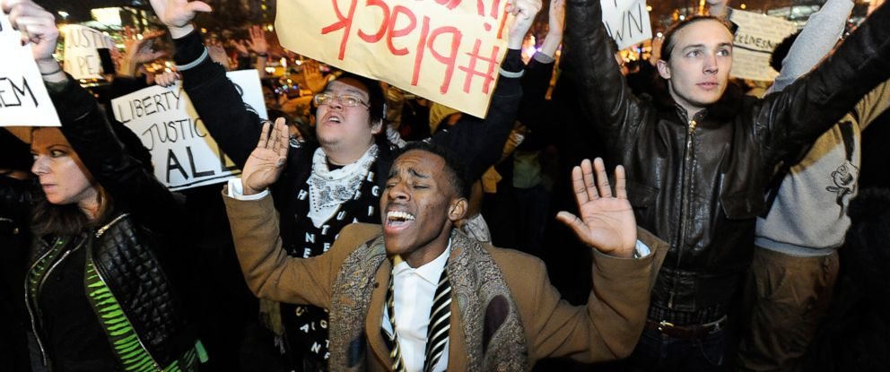 Protesters march in downtown Durham, N.C., Dec. 5, 2014 during a demonstration against the non-indictments of the police officers involved in the deaths of Michael Brown in Ferguson, Mo., and Eric Garner in New York City.