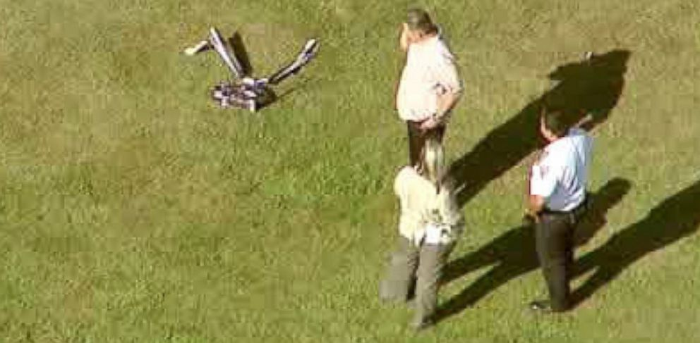 PHOTO: In this image taken from video and provided by WABC-TV in New York, investigators stand near a remote controlled toy helicopter that apparently struck and killed a 19-year-old man Sept. 5, 2013.