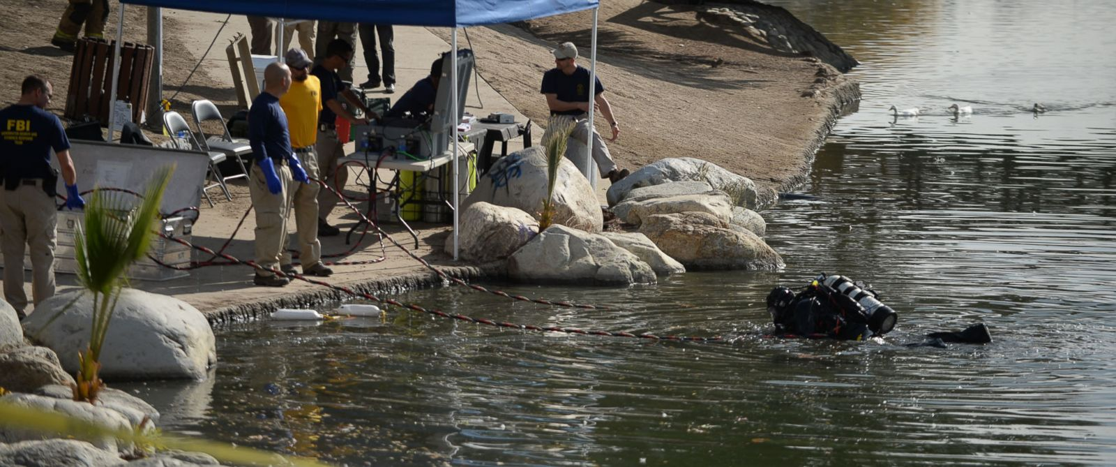 PHOTO: Members of the FBI Underwater Search and Evidence Response Team and bomb specialists work at Seccombe Lake on Thursday, Dec. 10, 2015 in San Bernardino, Calif.