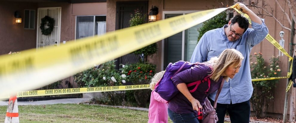 PHOTO: People leave their home in the neighborhood near a home being investigated in connection to the shootings in San Bernardino,Dec. 3, 2015, in Redlands, Calif.