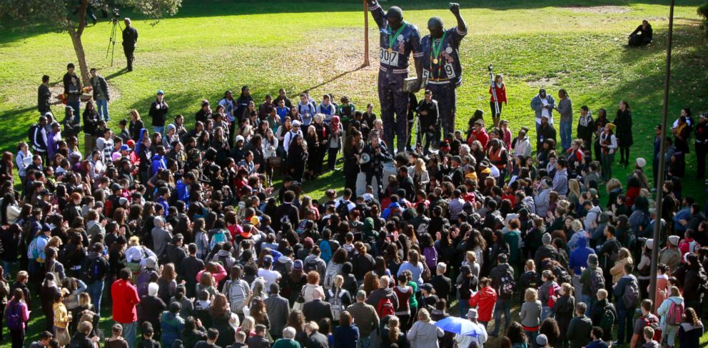 PHOTO: San Jose State University students gather around the 1968 Olympic statue while protesting a reported racial hazing of an African-American freshman student, Nov. 21, 2013, in San Jose, Calif.