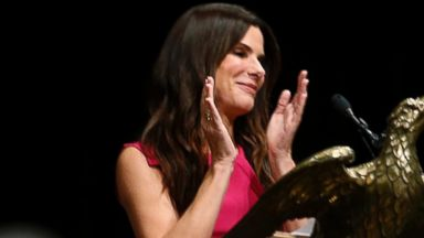 PHOTO: Sandra Bullock addresses Warren Easton Charter High Schools graduating seniors, May 19, 2014, in New Orleans.