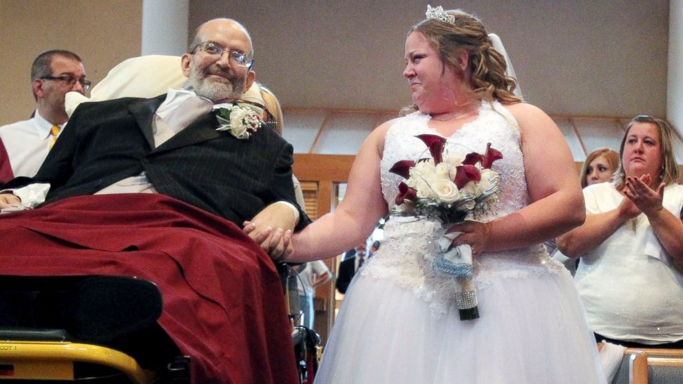 PHOTO: Bride Sarah Nagy, right, begins to cry as she is escorted by her father, Scott, down the aisle during her wedding ceremony, Oct. 12, 2013, at First Lutheran Church in Strongsville.