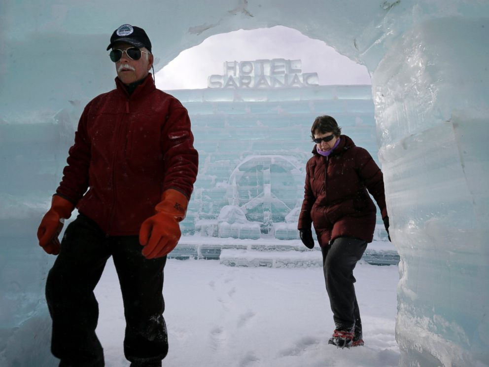 PHOTO: Dean Baker and his wife Marilynn Baker walk inside the Hotel Saranac ice palace