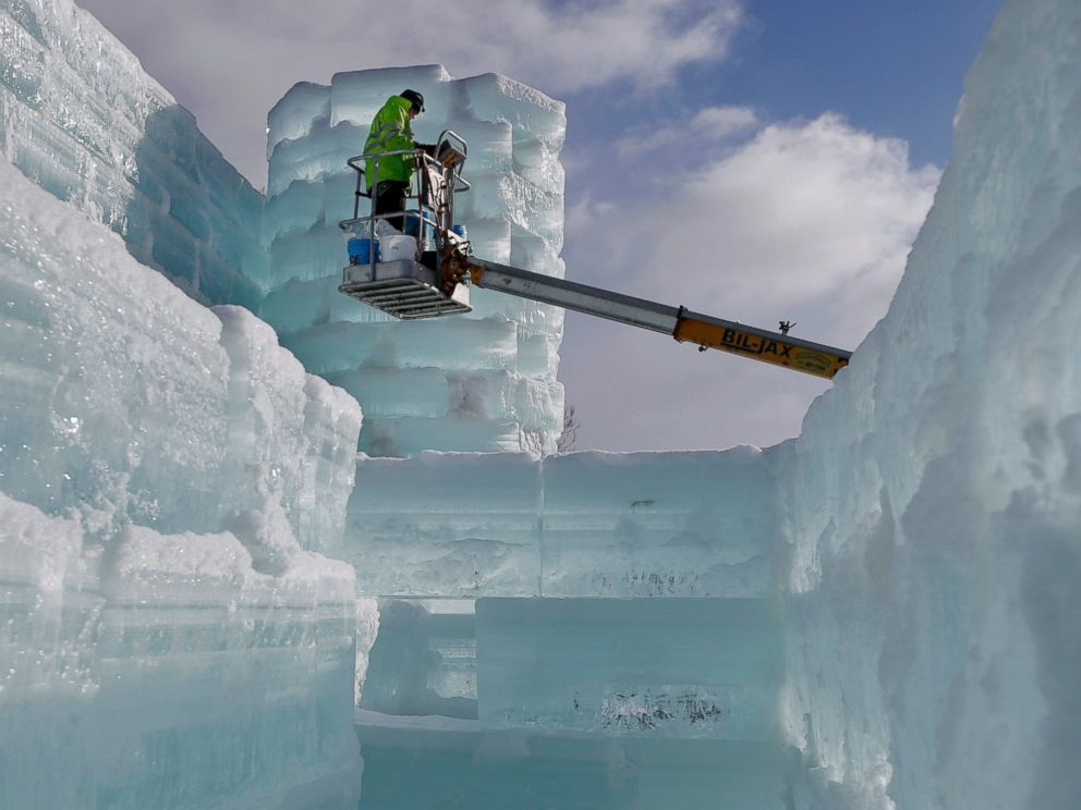 PHOTO: Volunteer John Pietras works on the Hotel Saranac ice palace in Saranac Lake, N.Y.