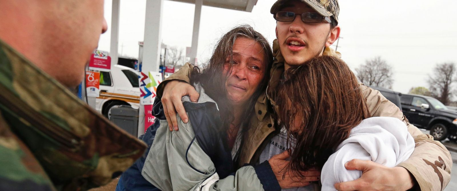 PHOTO: Dacia Winters, left, embraces Ryan Ficca, center, and Stormy Winters after they were evacuated in a Louisiana National Guard high water vehicle from rising floodwaters in Bossier Parish, La., March 10, 2016.