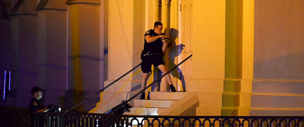 PHOTO: Charleston police officers search for a shooting suspect outside the Emanuel AME Church, in downtown Charleston, S.C., June 17, 2015.