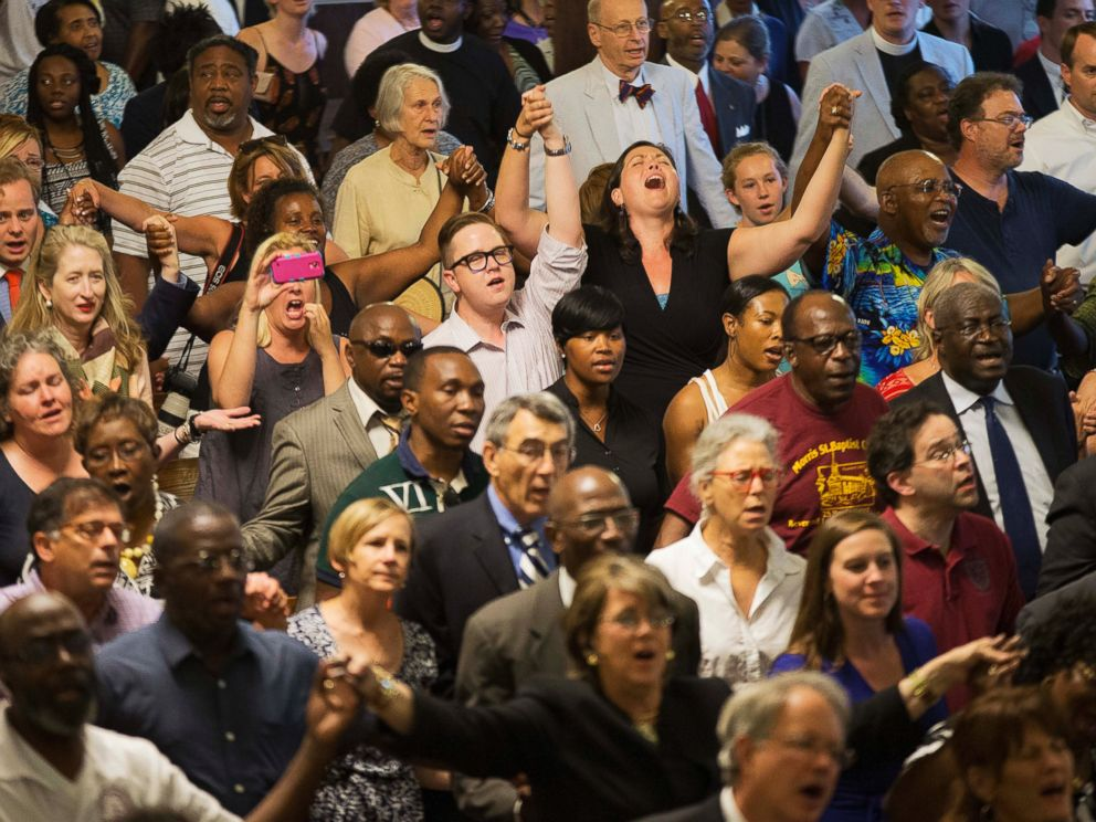 PHOTO: Parishioners applaud during a memorial service at Morris Brown AME Church for the people killed during a prayer meeting in Charleston, S.C., June 18, 2015.