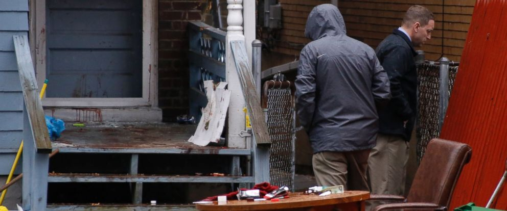 Allegheny County detectives look over the scene of a shooting, March 10, 2016 in Wilkinsburg, Pa. Police say multiple people were killed in the shooting late Wednesday and several were injured in suburban Pittsburgh.
