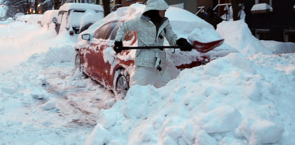 PHOTO: Liz Hall, of Albany, N.Y., digs her car out of snow in the Center Square neighborhood, Feb. 14, 2014, in Albany.