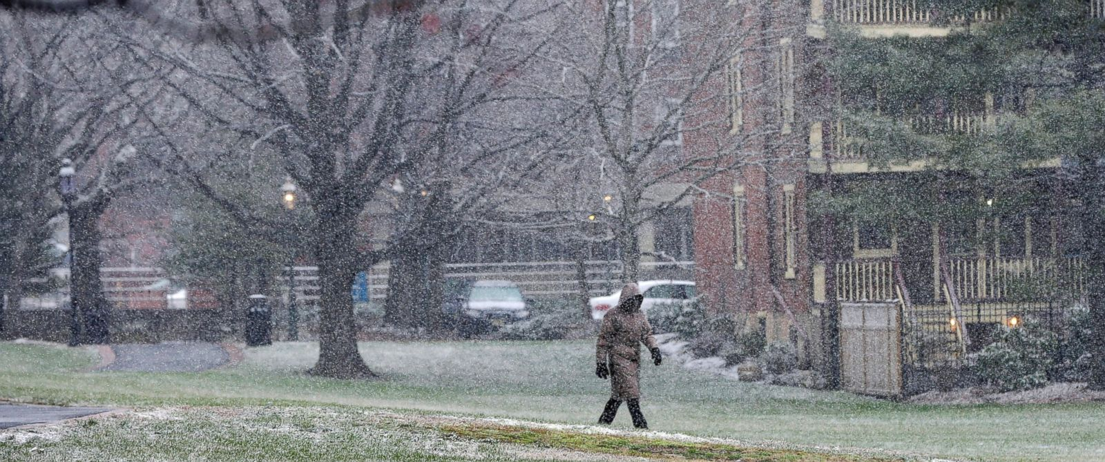 PHOTO: A person walks through a park in the falling snow on Jan. 17, 2016, in Trenton, N.J.