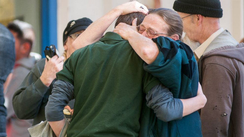 PHOTO: A Sparks Middle School student embraces with family members after a shooting at the school in Sparks, Nev., Oct. 21, 2013.