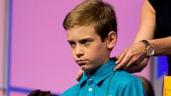 PHOTO: Andrew Lazenby, 11, of Baltimore, has his collar adjusted by a member of the staff before competing in the 2015 Scripps National Spelling Bee, May 27, 2015, at National Harbor in Oxon Hill, Md.
