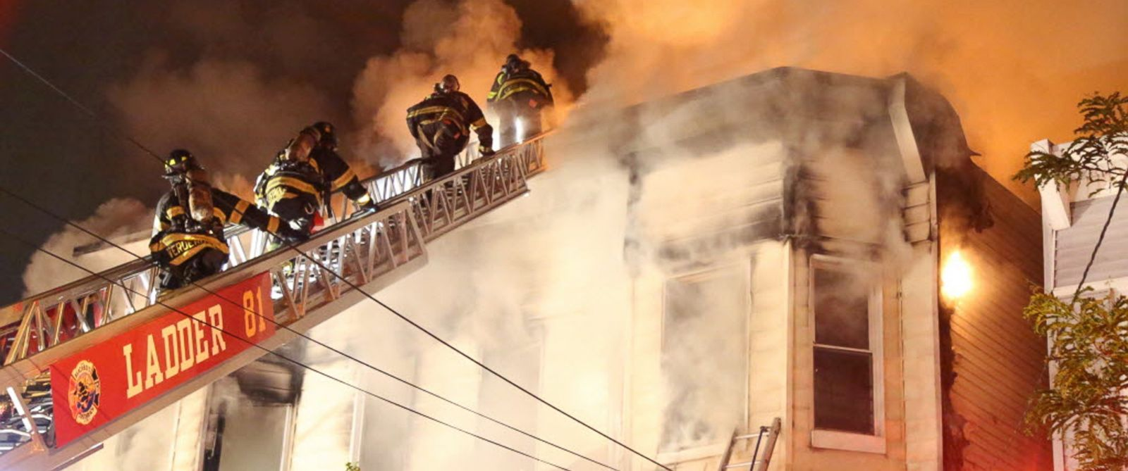 PHOTO: Firefighters battle a fire that tore through three townhouses on New York Citys Staten Island, June 5, 2014.