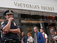 PHOTO:  New York City police officer stands in front of the Victorias Secret Herald Square store in midtown Manhattan, Thursday, Oct. 17, 2013, in New York.