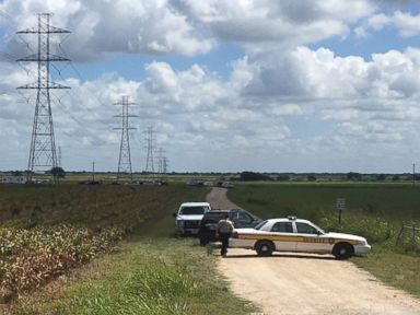 PHOTO: Police cars block access to the site where a hot air balloon crashed early Saturday, July 30, 2016, near Lockhart, Texas.