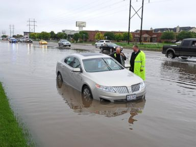 PHOTO: Amarillo police officers make an emergency water rescue of an stranded motorist after heavy rain showers flood much of the city, Saturday, May 23, 2015 in Amarillo, Texas.