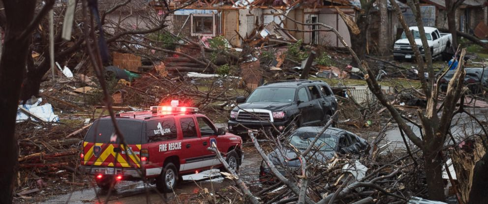 PHOTO: An emergency vehicle drives through a neighborhood in Rowlett, Texas, Dec. 27, 2015, the morning after it was struck by a tornado.